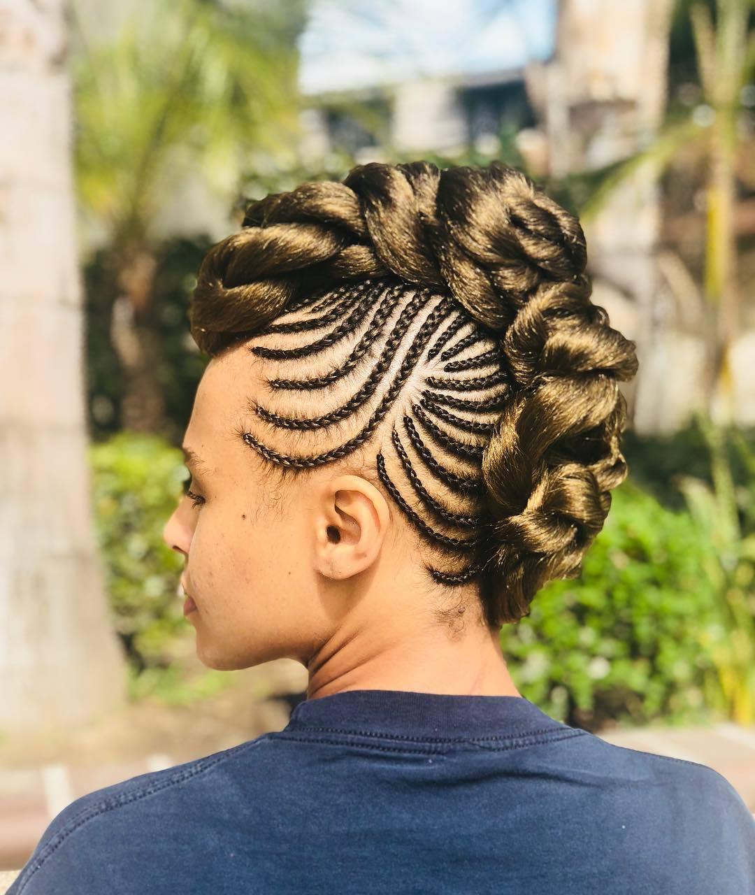 Woman with a cornrowed mohawk hairstyle