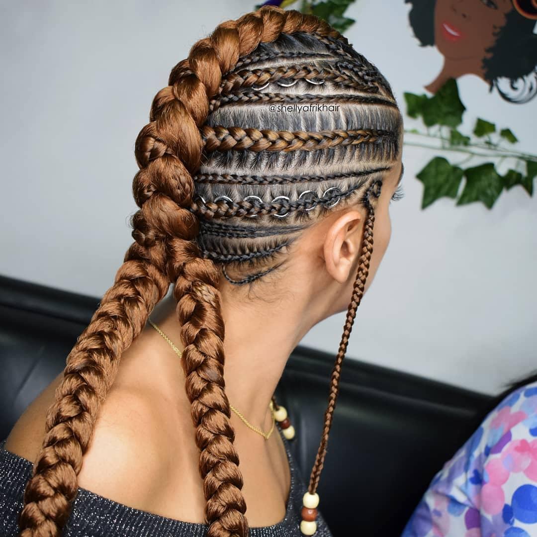 Woman with mohican style cornrows