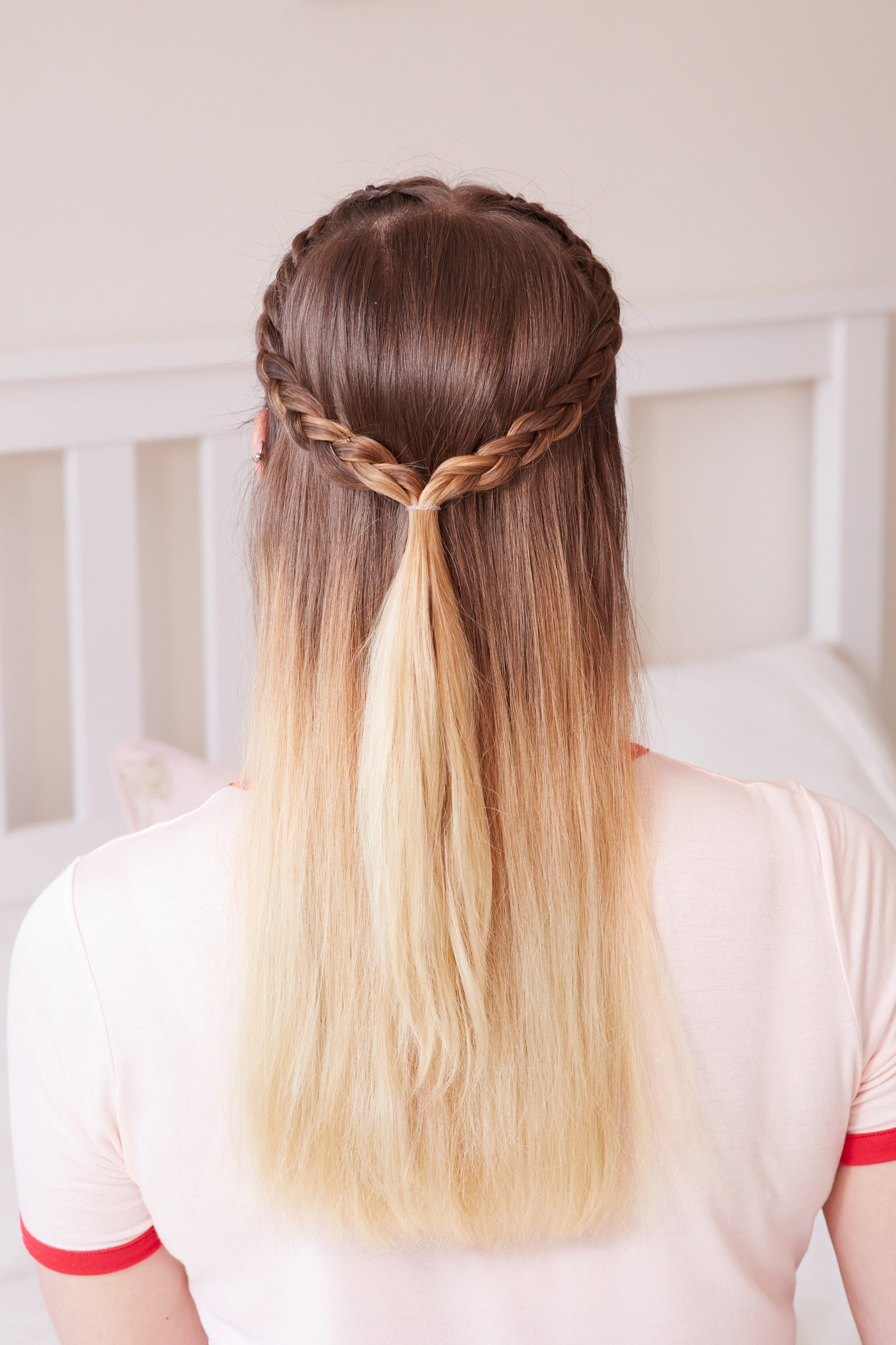 Woman with brunette and blonde ombre hair in a half-up half-down braid