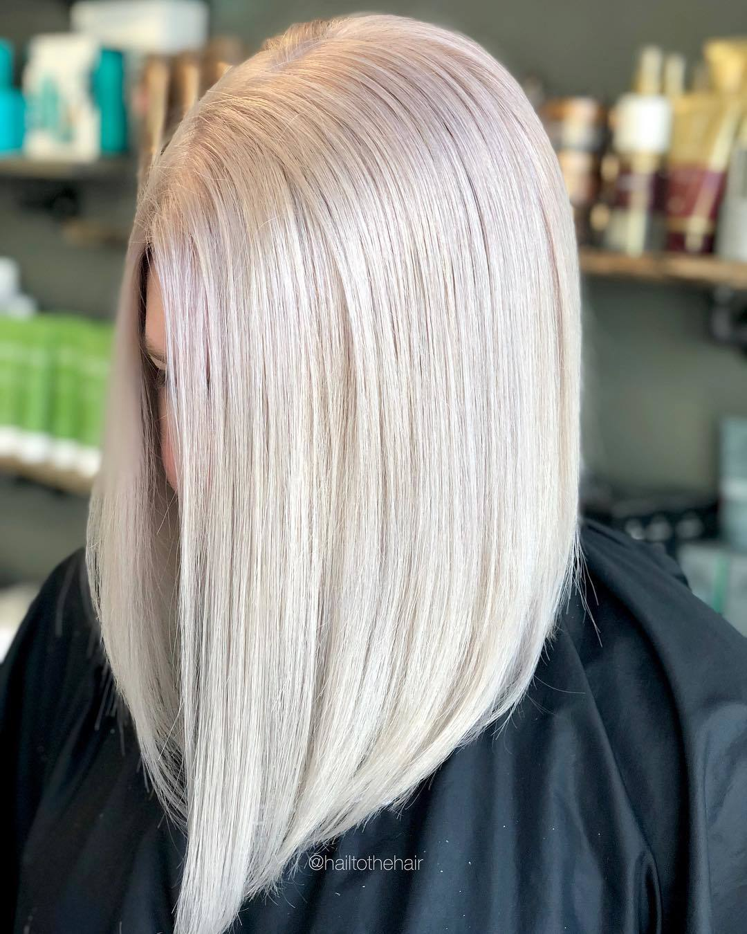 Woman with straight platinum lob haircut