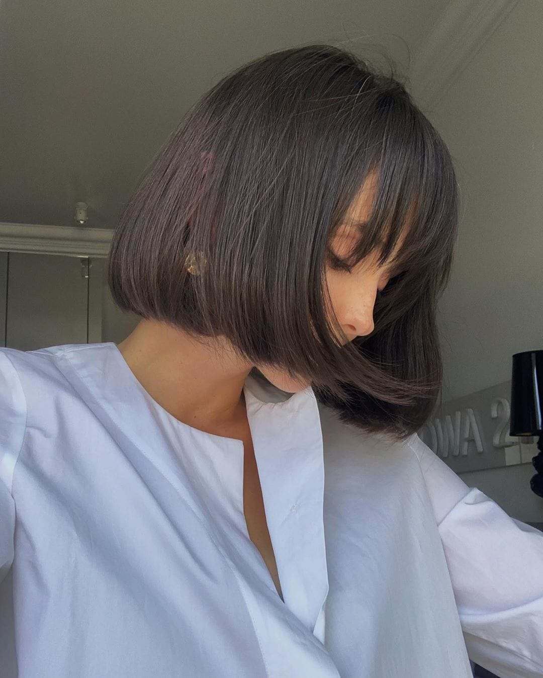 Woman with curled under short bob with wispy fringe