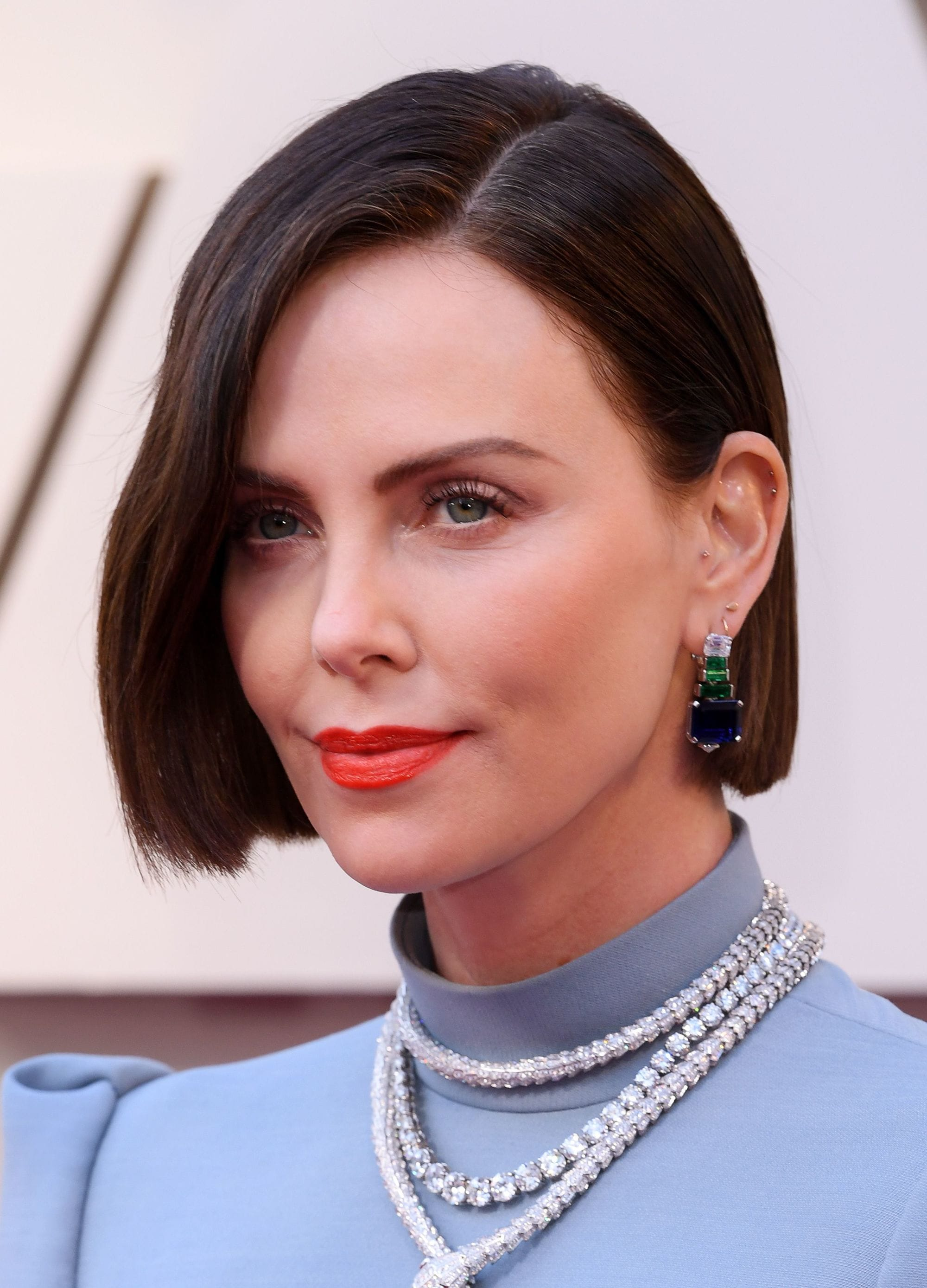 Charlize Theron with wavy side parted dark bob hairstyle