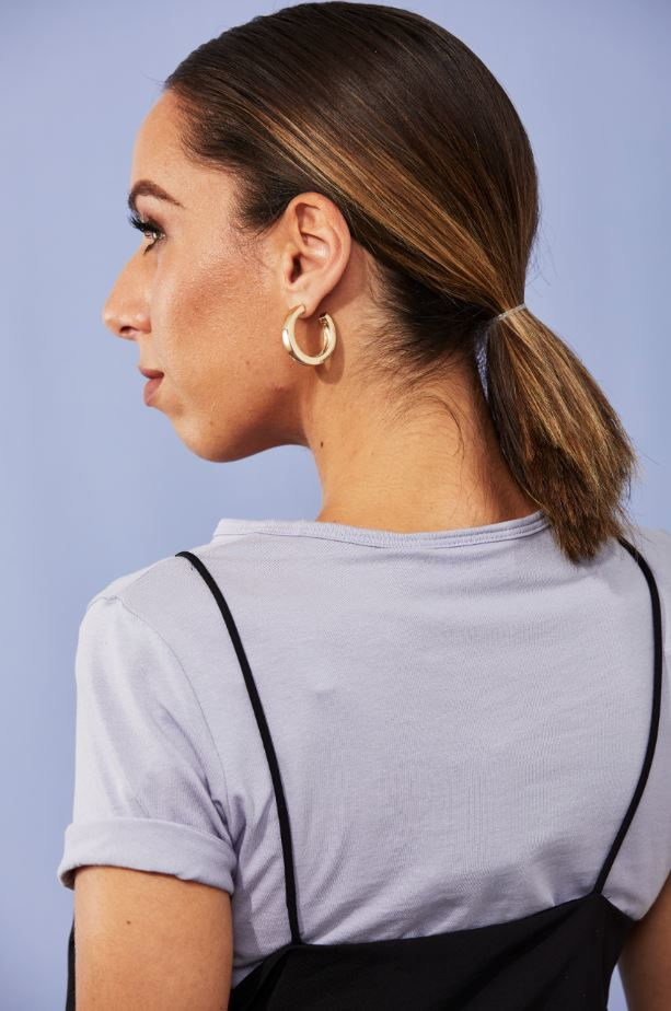 Woman with brown ombre hair in slick ponytail