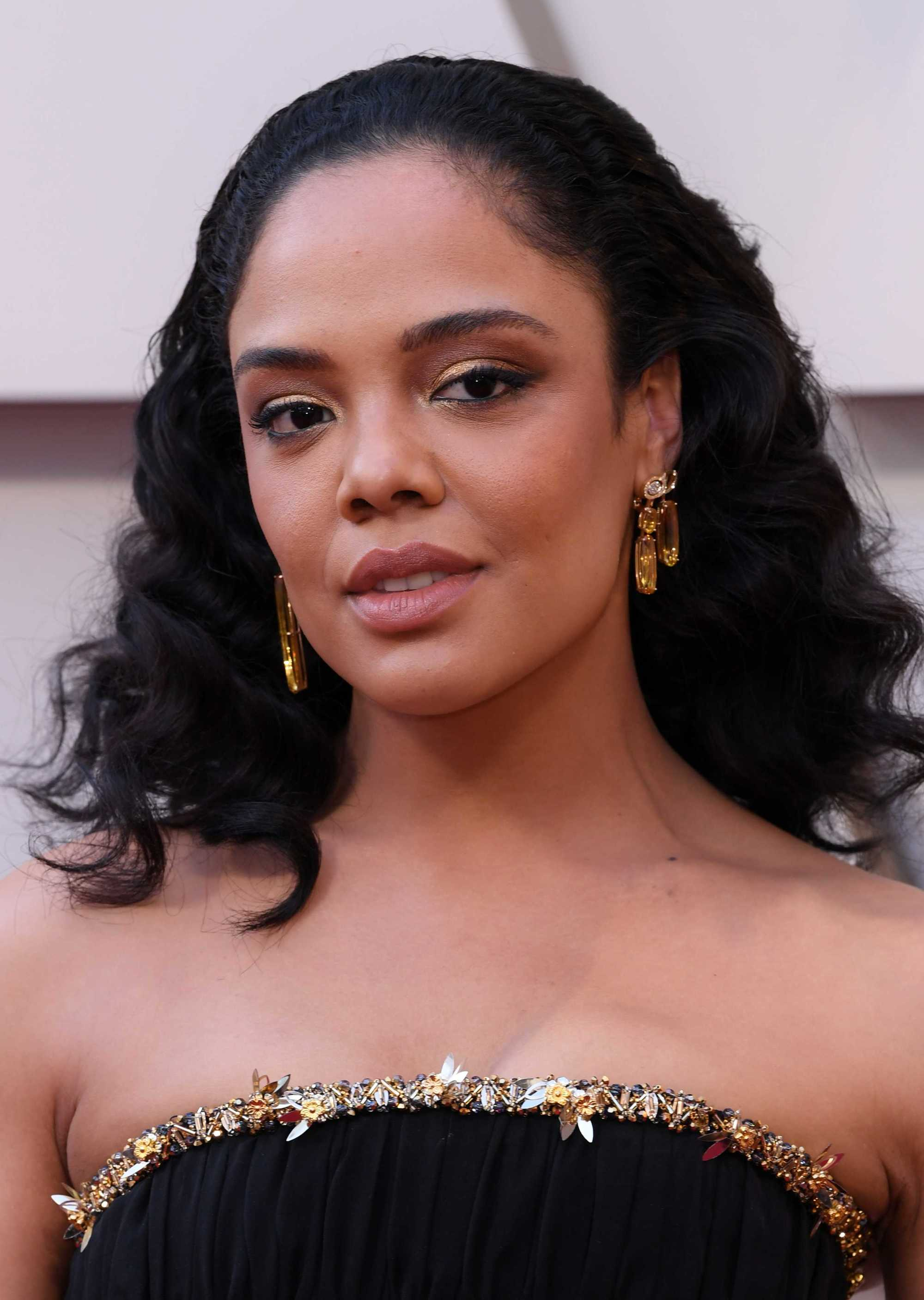 Tessa Thompson with dark swept back curls