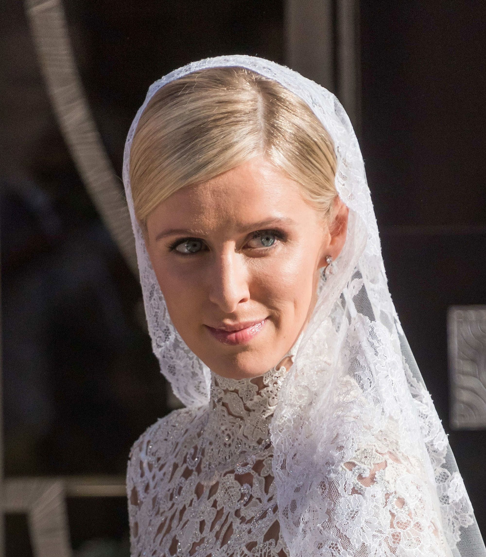 Nicky Hilton with sleek side part golden blonde hair