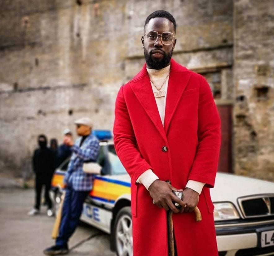 Ghetts with high tapper fade haircut with long beard