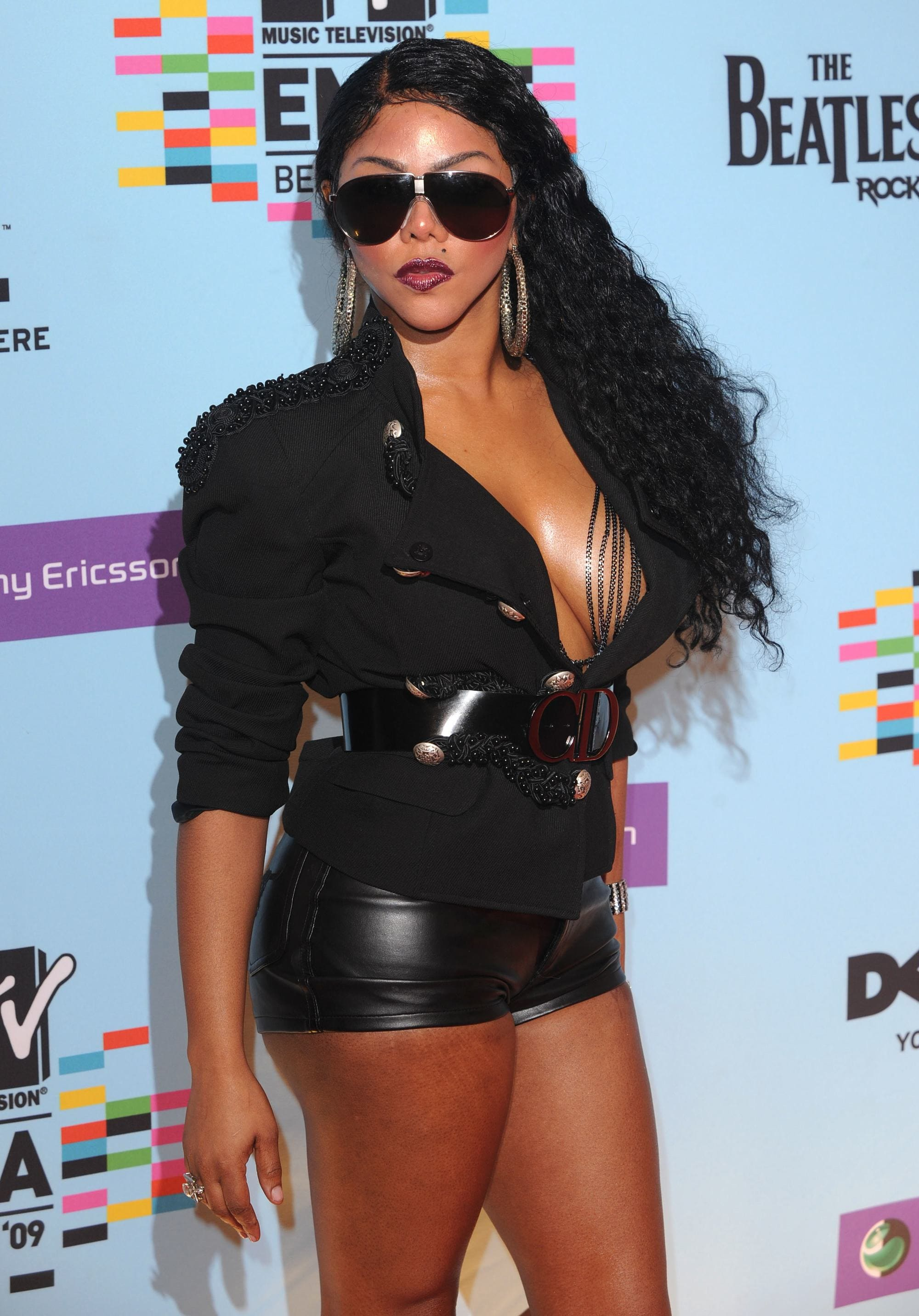 Lil Kim with long dark brown curly hair