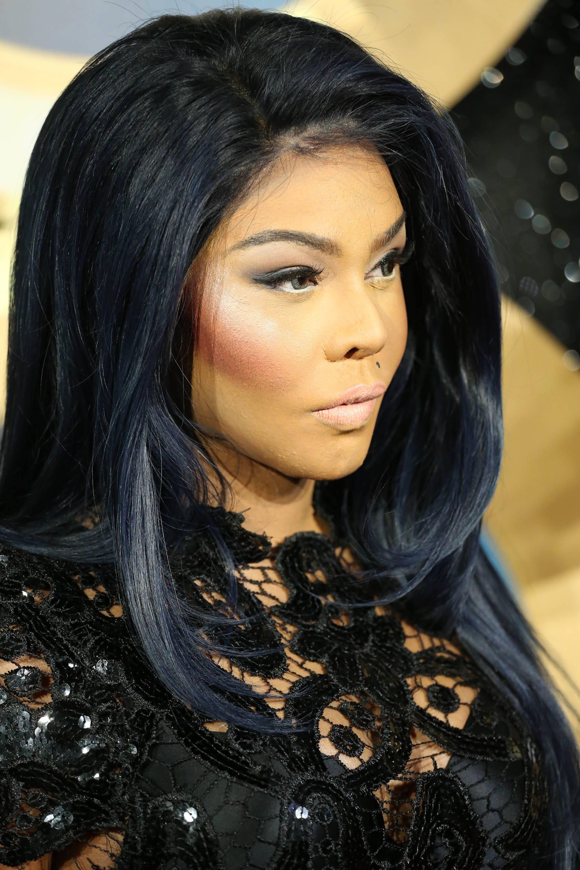 Lil Kim with dark brown straight and sleek medium length hair