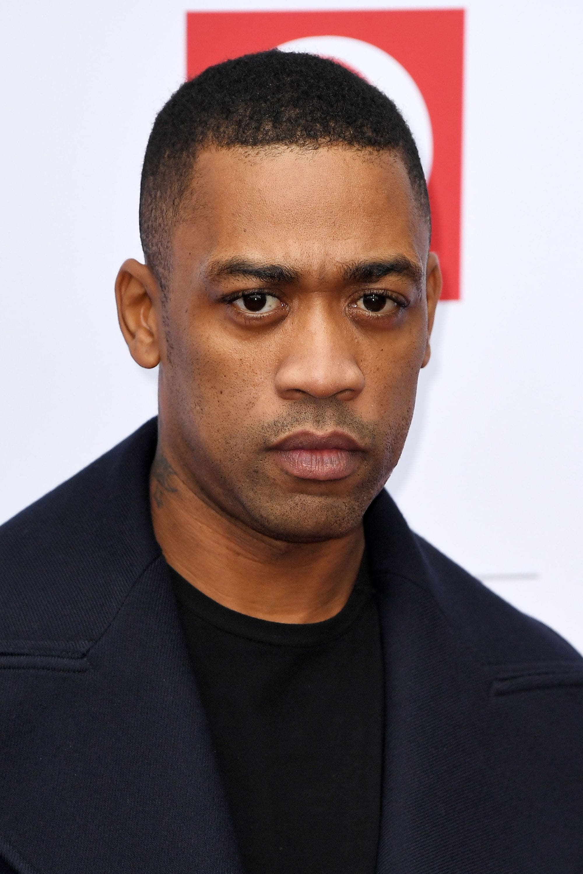 Wiley with tapper fade shaved haircut