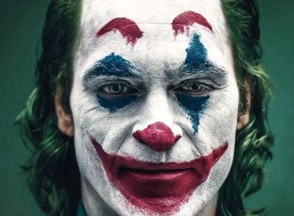Joaquin Phoenix as the Joker with green hair