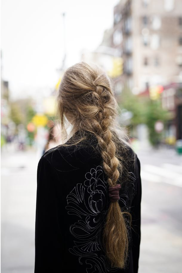 Back view of a woman with a loose French plait