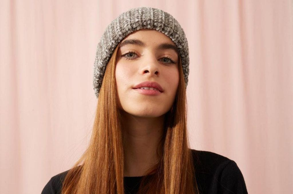 Young woman with beanie hat and long hair
