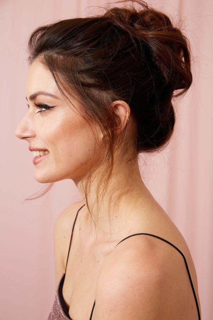 Brunette woman with her hair in a loose messy bun