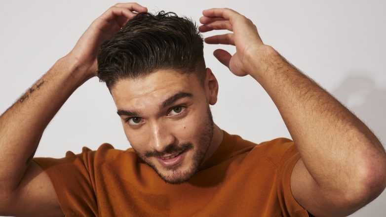 Man with short swept back messy quiff