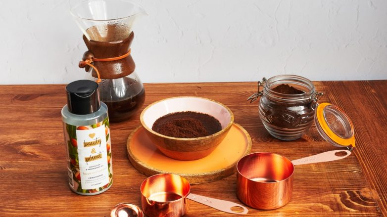 Shot of coffee, conditioner and kitchen utensils on a table