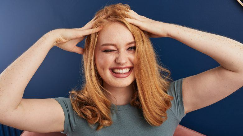 Woman touching her hair and smiling