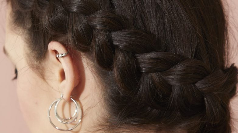 Close up of a brunette with a side Dutch braid hairstyle