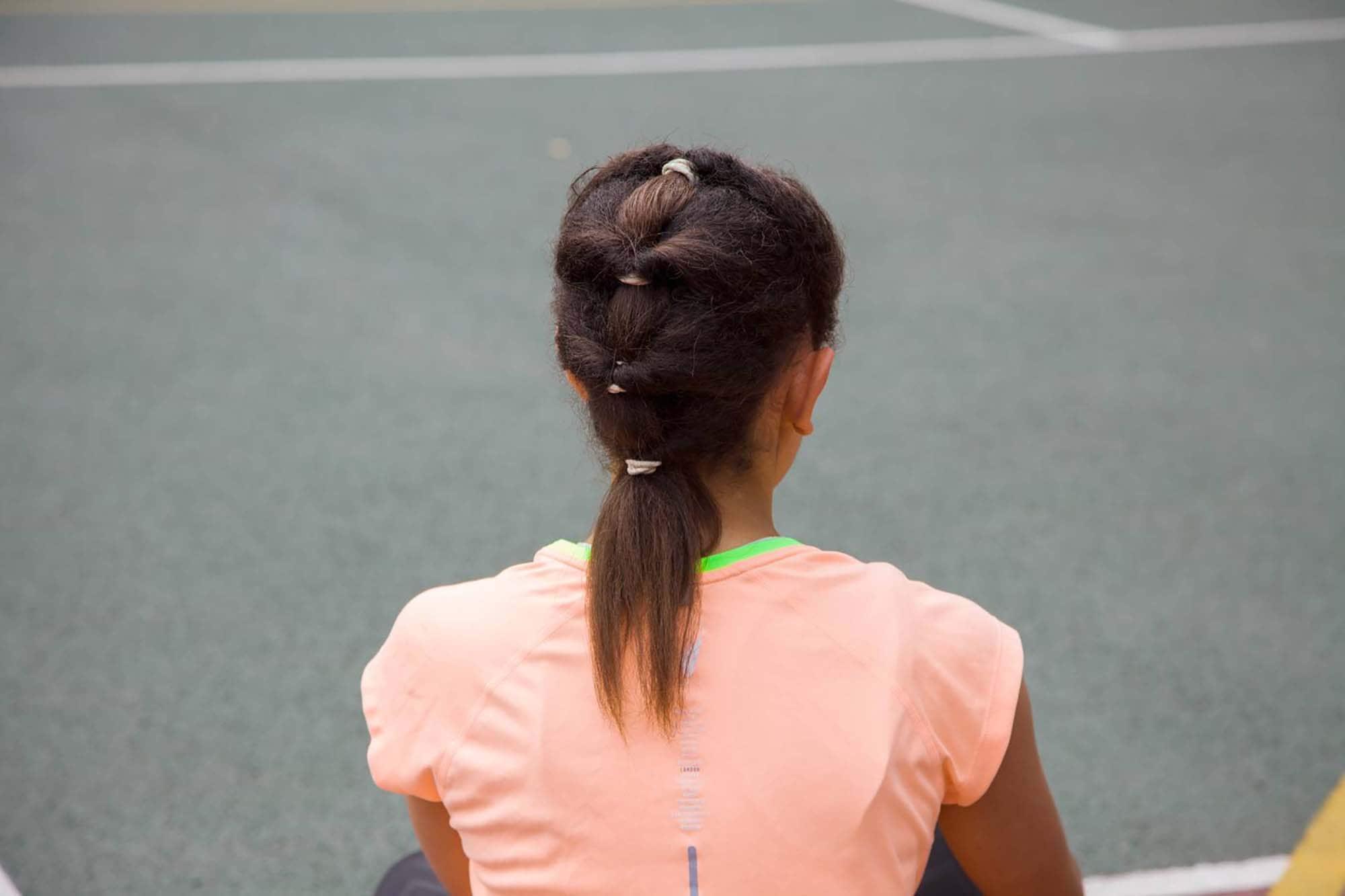 cabello al hombro varias colas de caballo