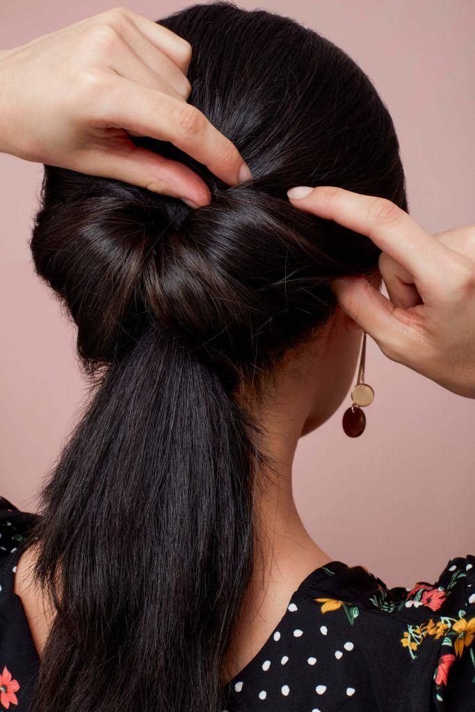 cola de caballo anudada elegante pelo negro