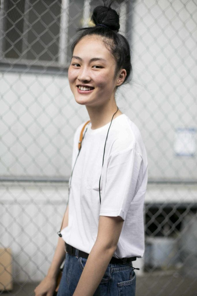 asian girl with a top knot bun hairstyle