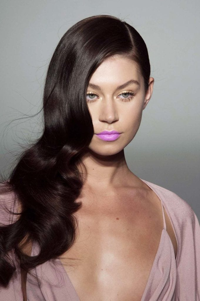 model with dark red hair and pink lips