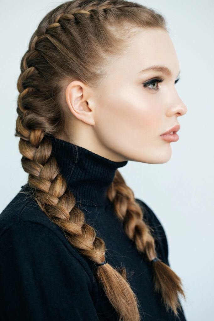 caucasian woman with double dutch braid hairstyle for long hair