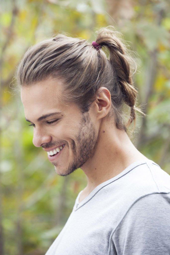 man with high ponytail man braid