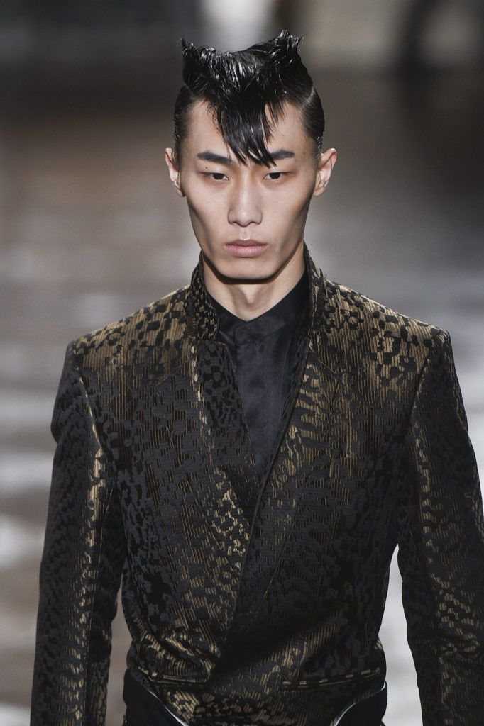 model with wet look quiff pompadour hairstyle