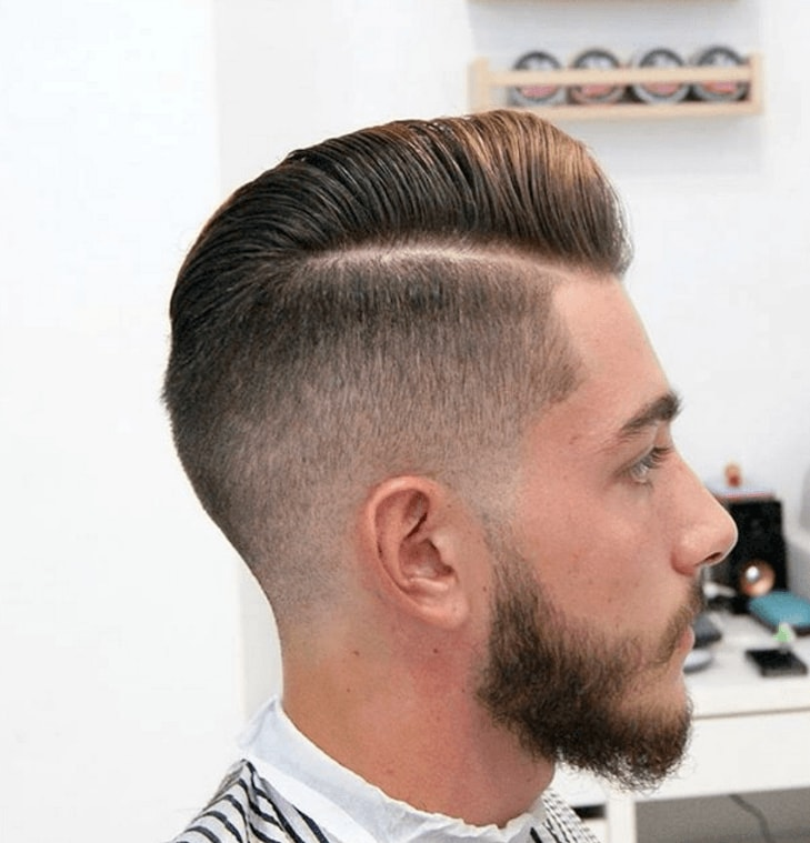 man with brown hair with razor fade pompadour hairstyle