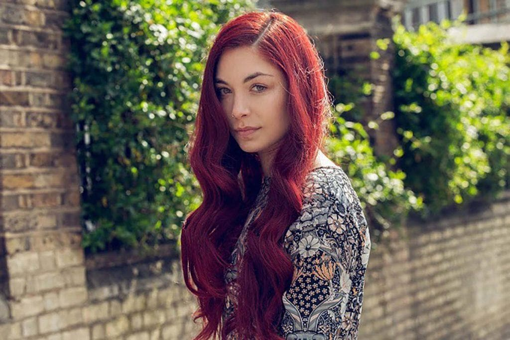 woman with long red hair burgundy hair color