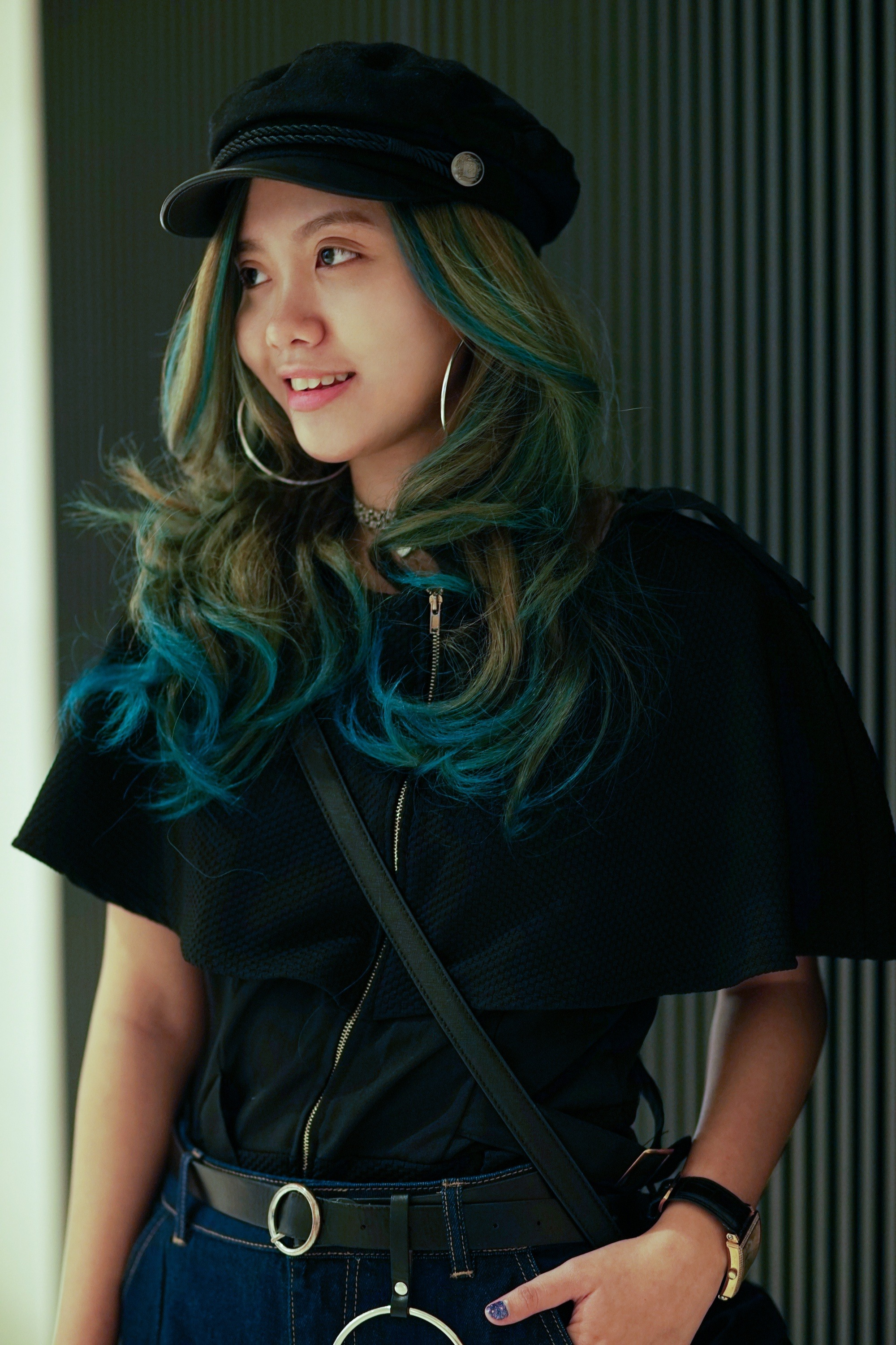How often should you change your hair color: Asian woman with long wavy multicolored hair wearing a black top