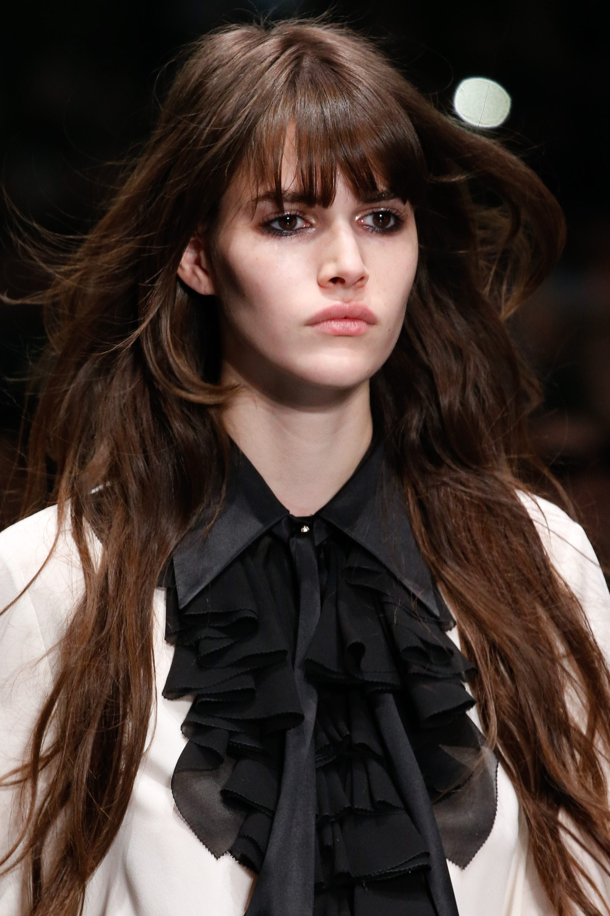 girl with heart-shaped face and bangs on the runway retro hairstyles