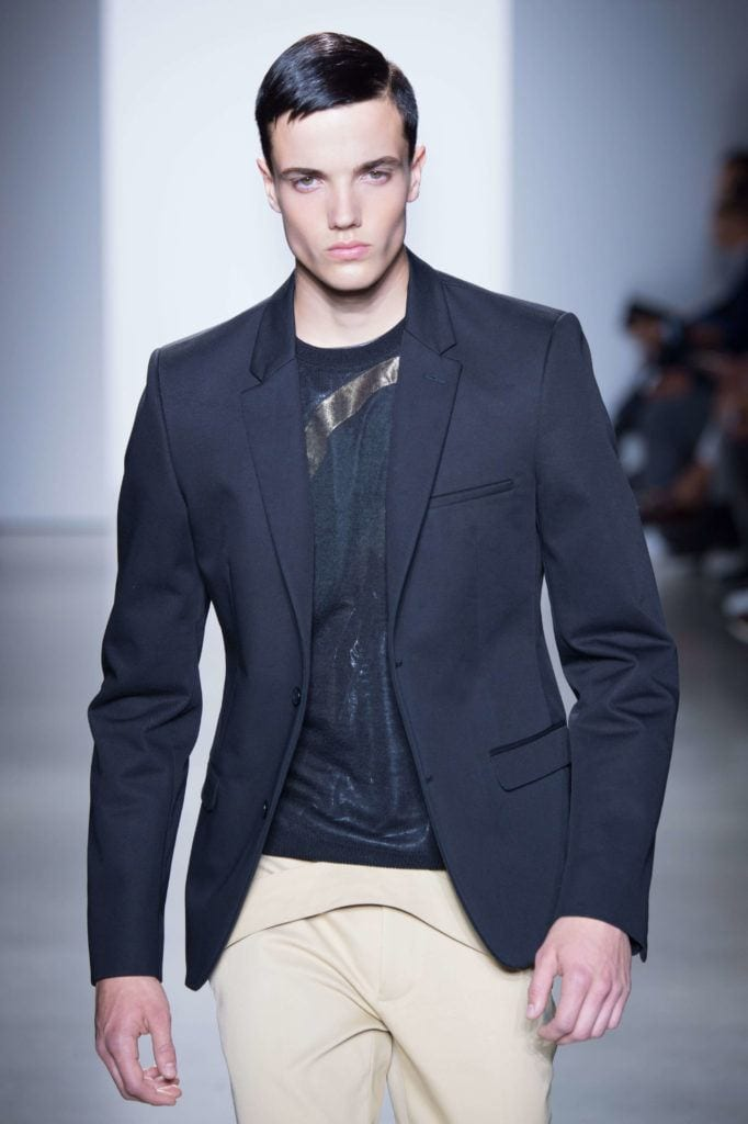 model man on the runway with slick hair