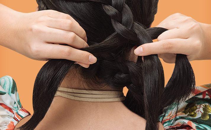 woman doing a braid