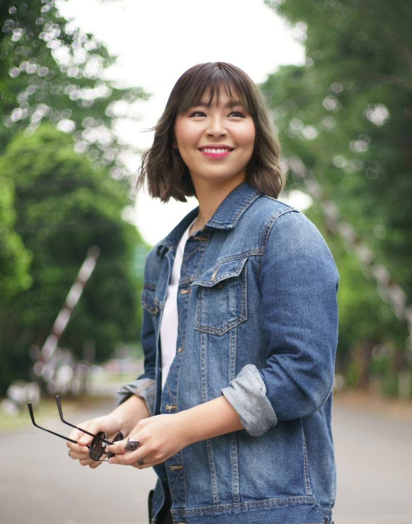 Asian woman with short hair and bangs for round face