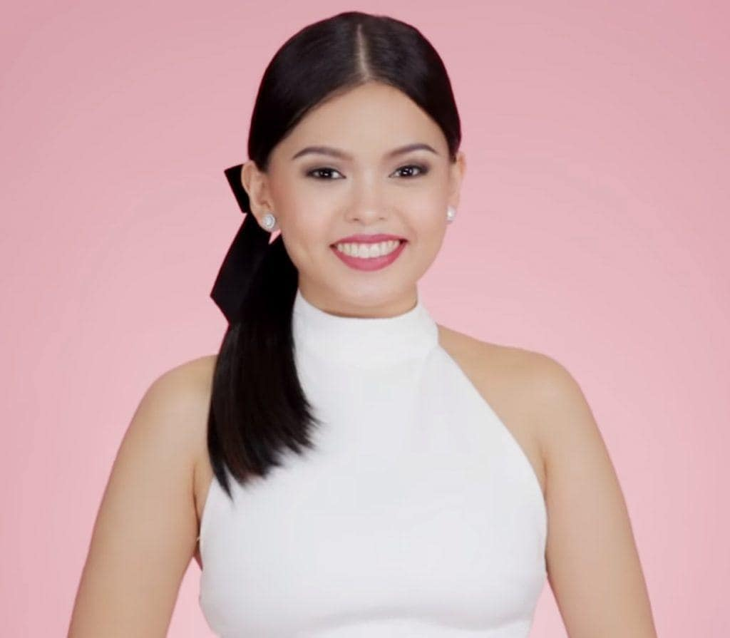 Filipina influencer with a festive bow ponytail hairstyle smiling