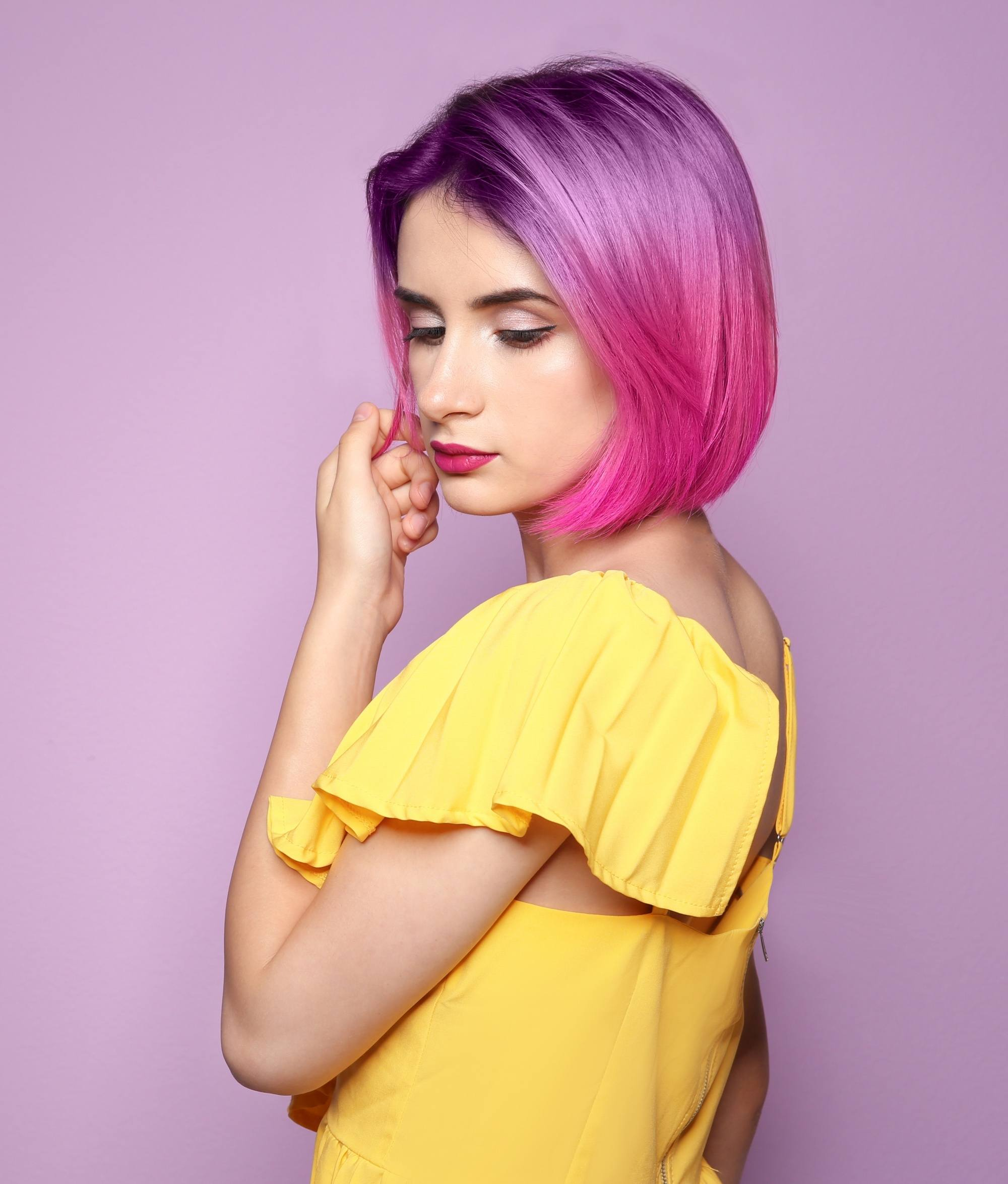 Woman with purple to pink ombre bob