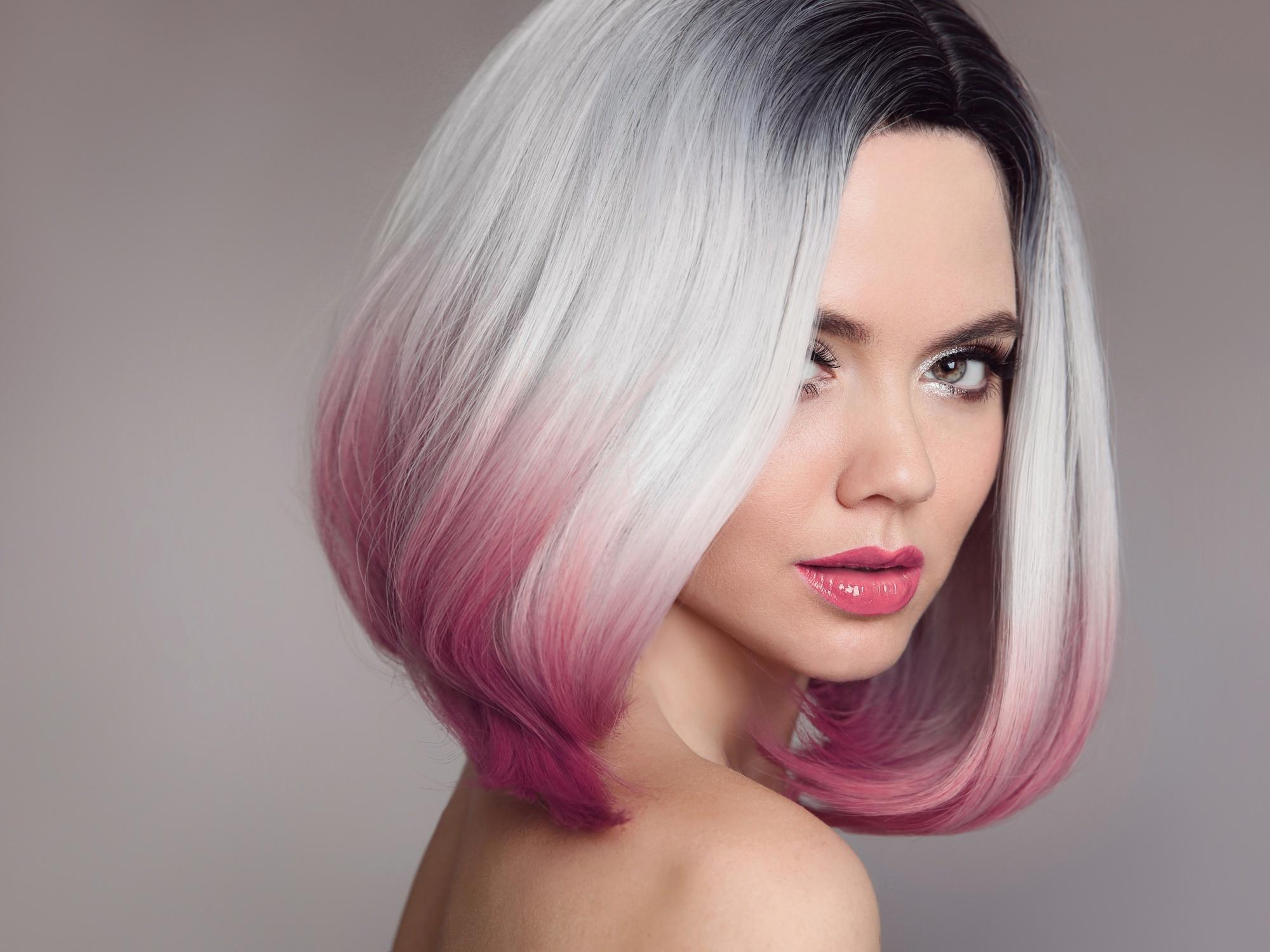 Woman with blonde to pink reverse ombre short hair