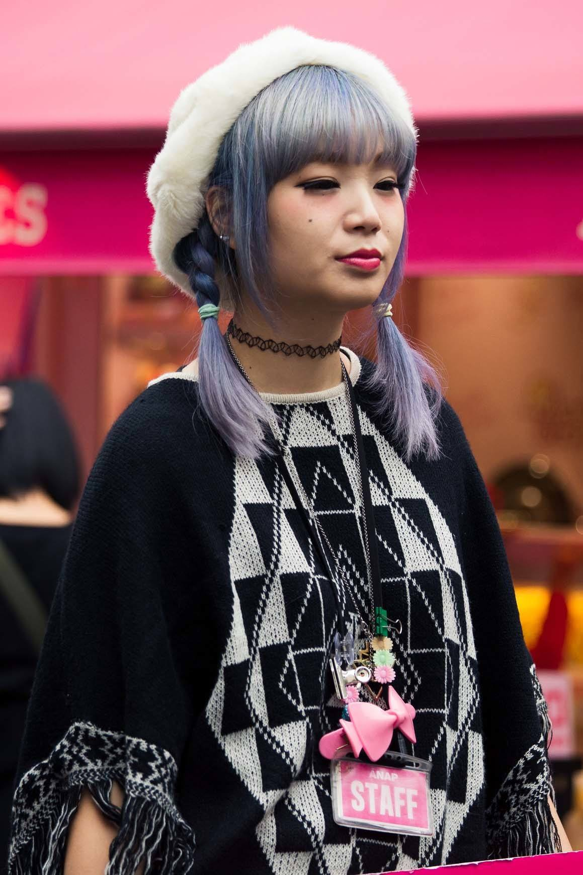 pastel hair colors: Girl with lavender hair in two braids wearing a bonnet and black sweater