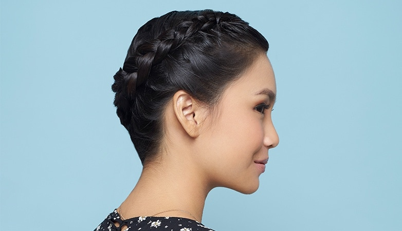 rope braid updo: woman showing off her halo braid