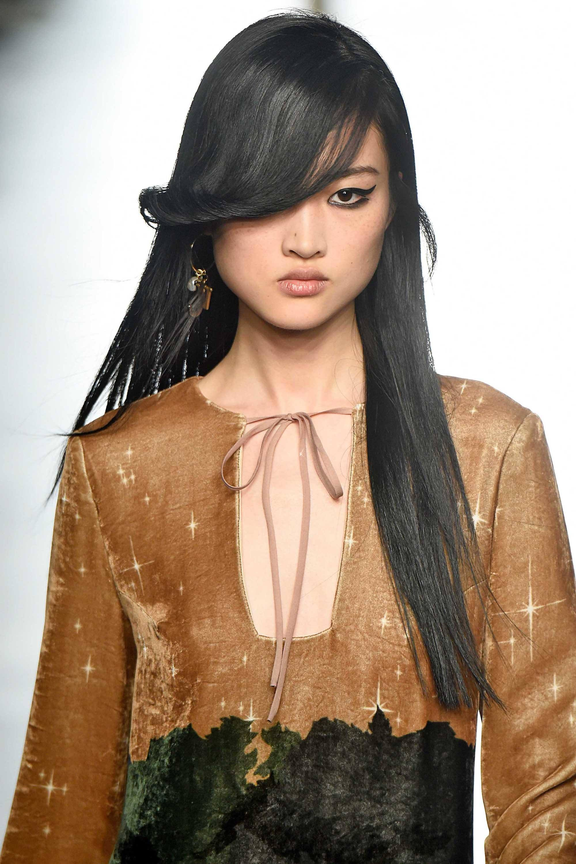 Asian woman with black long hair and side bangs