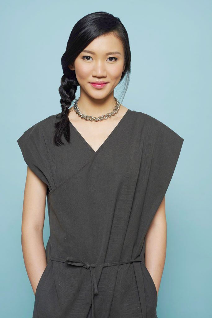 Asian woman with a side braid wearing a romper