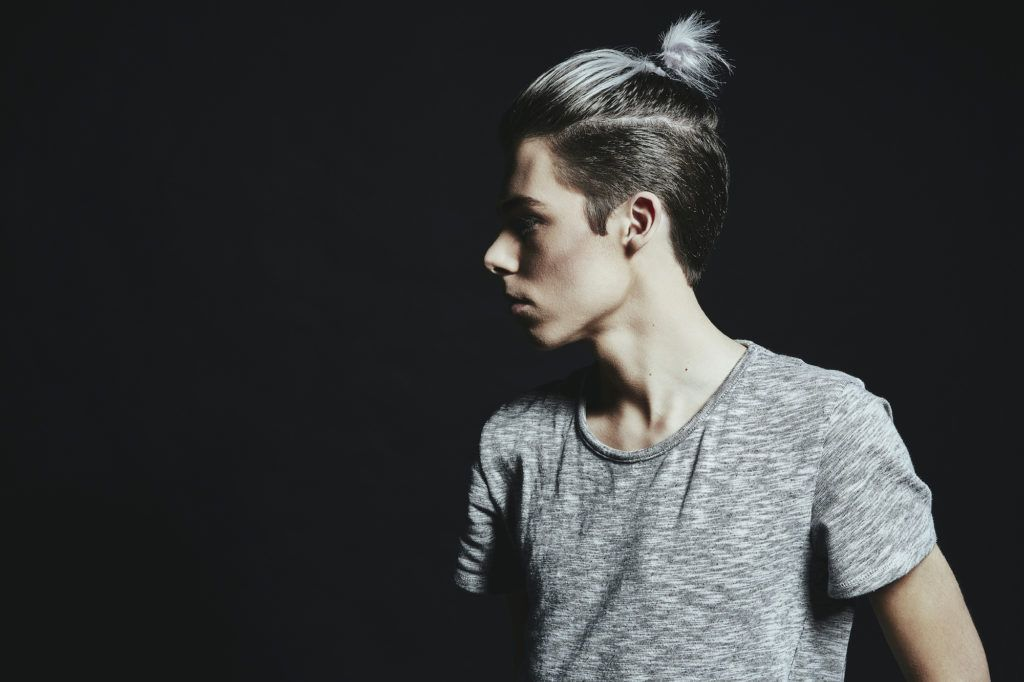 disconnected undercut with short ponytail