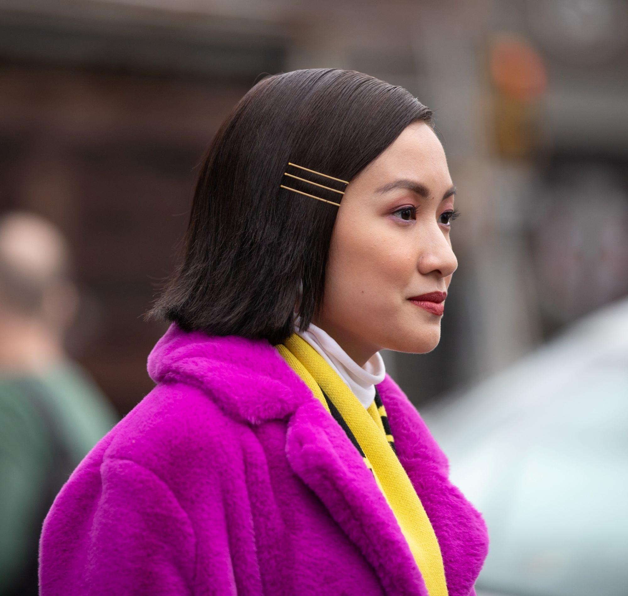 Short hairstyles for Filipinas: Closeup profile shot of Laureen Uy with short dark hair wearing a pink coat