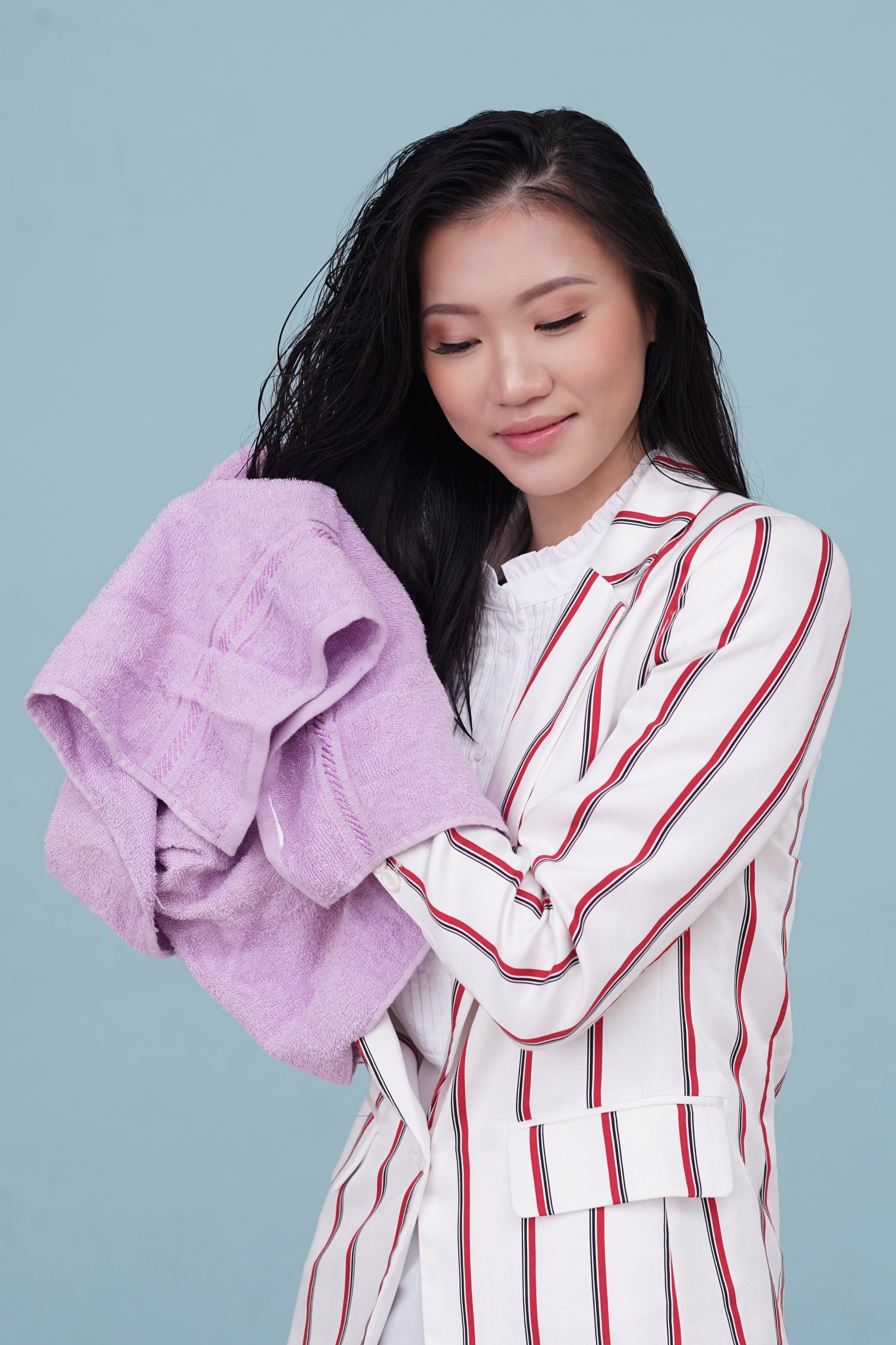Brush your hair the right way: Asian woman towel drying her long dark hair