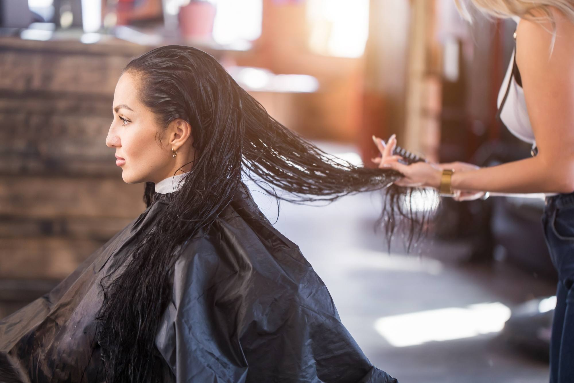 Keratin Smoothing Treatment: Woman with long hair at a salon