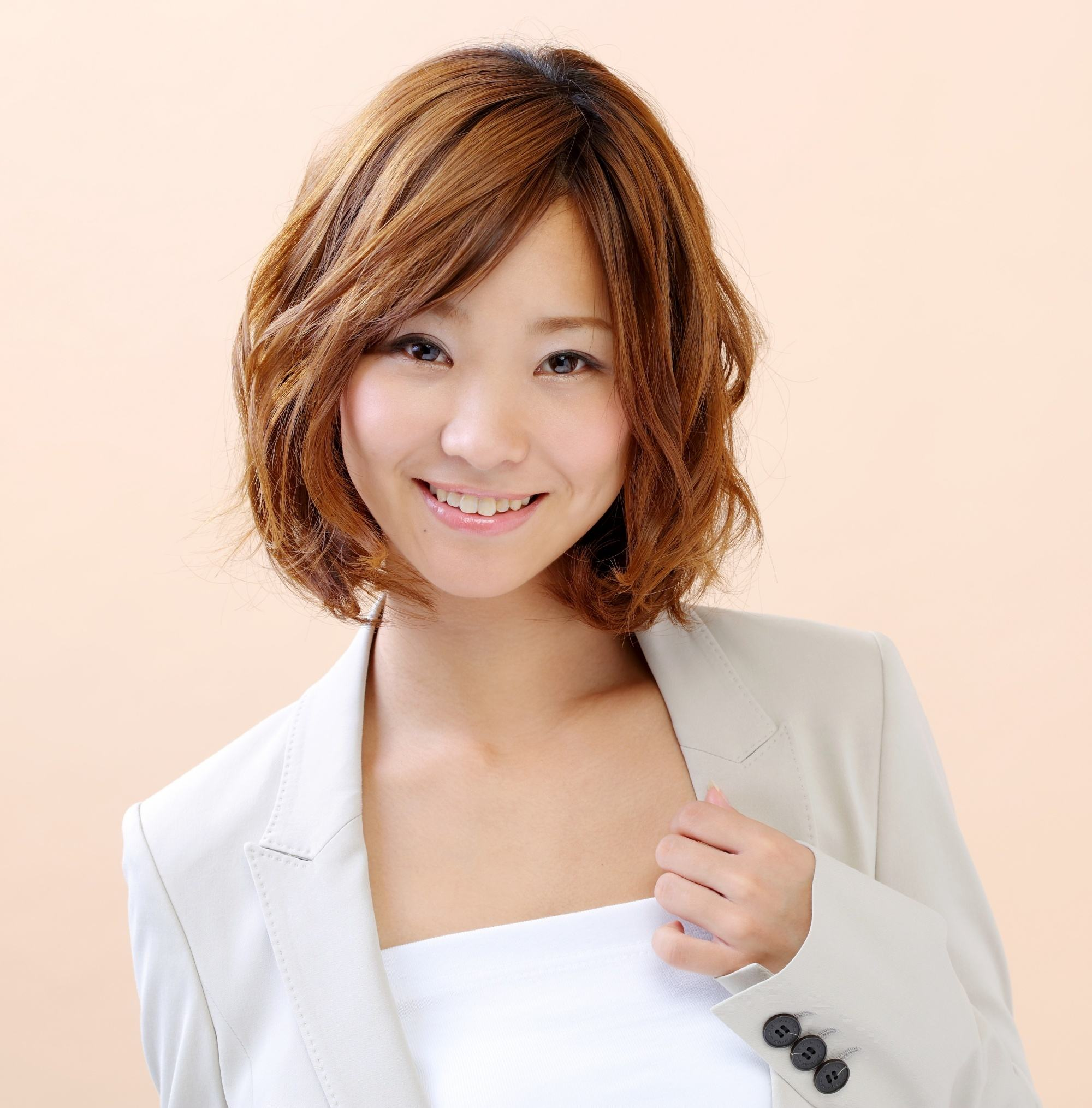 Japanese woman with brown short wavy hair smiling