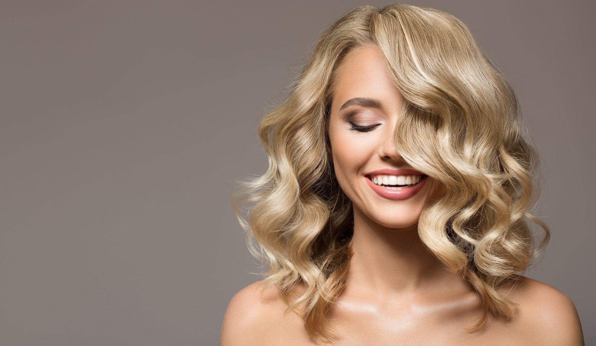 How To Curl Medium Length Hair Using A Flat Iron
