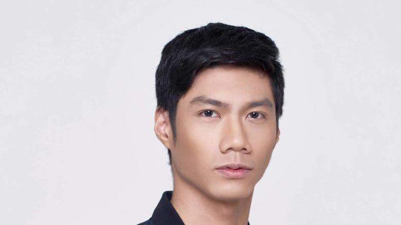 Scalp care men: Closeup shot of an Asian man with short black hair
