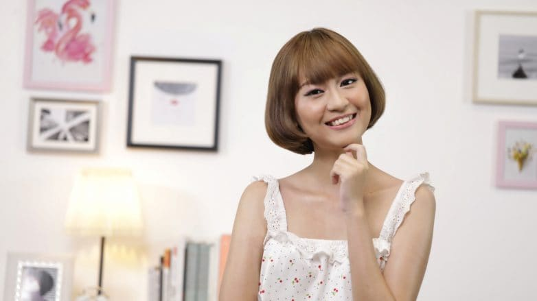 Asian woman with short hair and bangs